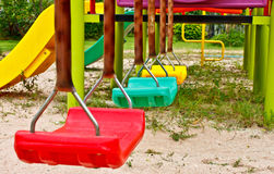 Colorful swing set. At playground royalty free stock photos