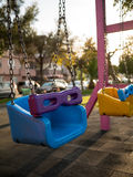 Colorful swing set at playground in a park Royalty Free Stock Photography