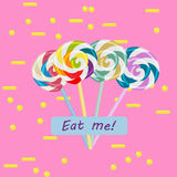 Colorful swirl lollipop set on bright pink background Royalty Free Stock Image