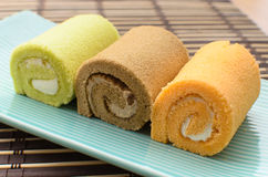 Colorful swiss roll on green dish Royalty Free Stock Images