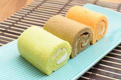 Colorful swiss roll on green dish Royalty Free Stock Photo