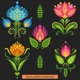 Colorful symmetrical flowers on dark background. Elements of traditional Slavic ornaments. Vector illustration Stock Photos