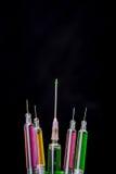 Colorful syringe  on  dark background Stock Photography