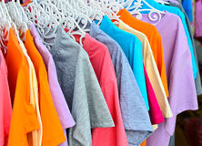Colorful t-shirt on hangers Royalty Free Stock Photography