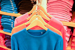 Colorful t-shirt on rack Stock Photography