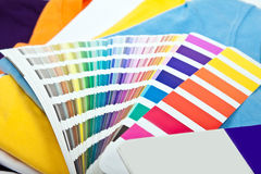 Colorful t shirts and color scale Stock Images
