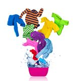 Colorful T-shirts flies out of the laundry bowl stock photos