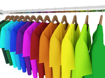 Colorful t-shirts with hangers isolated on white. 3d Royalty Free Stock Images