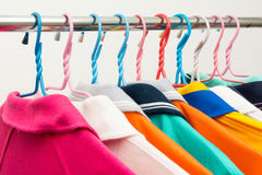 Colorful T-shirts on hangers Royalty Free Stock Photo