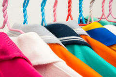 Colorful T-shirts on hangers Stock Image