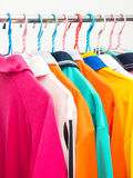 Colorful T-shirts on hangers Stock Photography