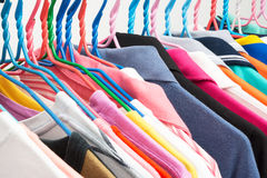 Colorful T-shirts on hangers Royalty Free Stock Image