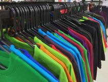 Colorful T-Shirts Hanging on a Rack Stock Photography