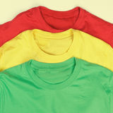 Colorful t-shirts. Red, green and yellow t-shirts Stock Image