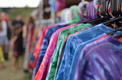 Colorful T-shirts. Set of t-shirts in different colors at festival booth stock photos
