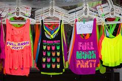 Colorful T-shirts sold on the street shop during the full moon party.  Island Koh Phangan, Thailand Stock Image
