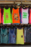 Colorful T-shirts sold on the street shop during the full moon party. Island Koh Phangan, Thailand Stock Photo