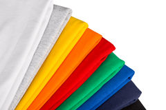 Colorful t-shirts. Stack of colorfull cotton shirts isolated Stock Photos