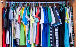 Colorful t-shirts in wardrobe. Royalty Free Stock Image