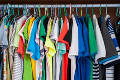 Colorful t-shirts in wardrobe. Royalty Free Stock Photography
