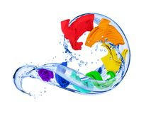 Colorful t-shirts in water splashes isolated on white background.  Stock Photography
