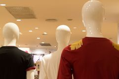 Colorful t-shirts worn by mannequin on sale in departmentstore. Colorful t-shirts on event show Royalty Free Stock Images
