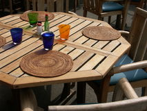 Colorful table. Colorful restaurant wood table with chairs stock photography