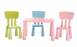 Colorful table and chairs for little kids. Isolated on white royalty free stock photography