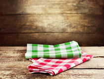 Colorful tablecloth on wooden table Royalty Free Stock Photos