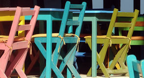 Colorful Tables & Chairs. Colorfully painted wooden tables and chairs at outdoor restaurant Royalty Free Stock Images