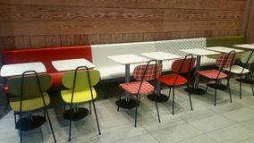 Colorful tables, chairs and stools. In contemporary style Royalty Free Stock Photo