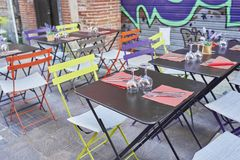 Colorful tables on the terrace of a bar royalty free stock images