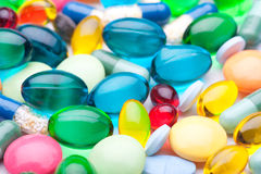 Colorful tablets with capsules Royalty Free Stock Photos