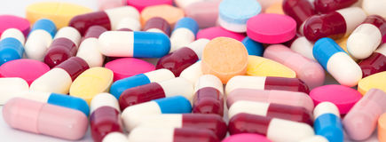 Colorful tablets with capsules Stock Photography