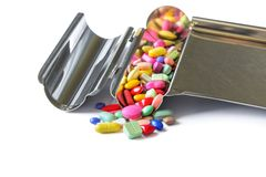 Colorful tablets medicine on the drug counting tray. Royalty Free Stock Photos