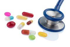 Colorful tablets a stethoscope Royalty Free Stock Photo