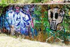 Colorful tag on the walls of a ruin Stock Images