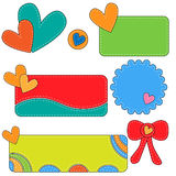 Colorful tags, labels and bow with hearts Royalty Free Stock Image