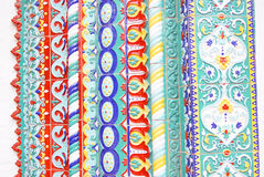 Colorful tails. Decoration of a church facade. Stock Photography