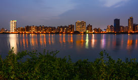 Colorful Taipei city lights reflecting in the Tamsui River at night in Taiwan Stock Photos