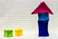 Tall toy brick house. Colorful tall house from little soft bricks Stock Photo