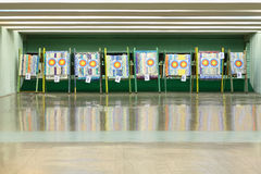 Colorful targets for archery. With holes from arrows inside shooting range Royalty Free Stock Image