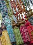 Colorful tassels for curtains. Detail shot Stock Photos