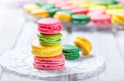 Colorful tasty macaroons on napkin, natural light selective focus. Sweet and colorful dessert Royalty Free Stock Photos