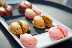 Colorful tasty macaroons in a row Stock Photography