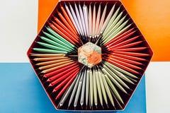Colorful tea bag set. Hexagon box with tea bags. royalty free stock images