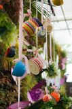 Colorful tea cups garden decoration idea. Colorful tea cup garden decoration idea stock photos