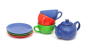 Colorful tea cups with teapot Stock Photos