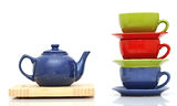 Colorful tea cups with teapot Stock Image