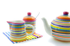 Colorful teapot and milk jug and sugar bowl Stock Photography